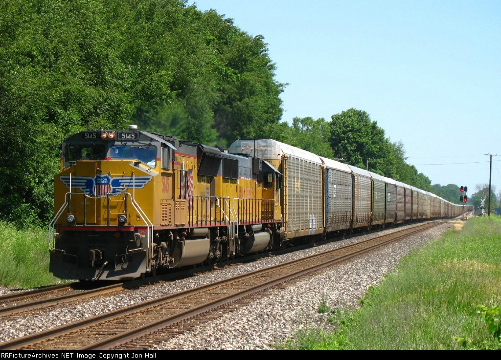 UP 5145 & 2234 leading west with E251 stretched out behind them