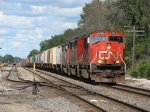 CN 5792 leading a different looking Q149 westward