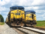 CSX 94 rests on the main with the front of Q334 as 7892 sits in the siding with the rest of the train