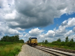 CSX 7892 sitting under the big puffy midday clouds
