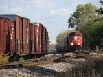 CN 5627 leading Q335-20 past the siding