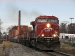 CP 9632 rolling through town with X500-16 stretched out behind it