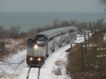 After making the station stop, the Pere Marquette is cruising west again with the cold waters of Lake Michigan behind it