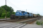 Conrail power leads mix and match hoppers west