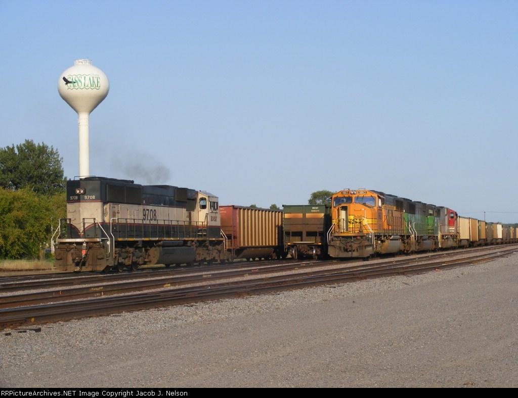 A DPU passing a coal empty in the CL yard