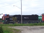 IC 9625 Tries to Hide Behind a Tree and a Lamp Post While a Doublestack Train Passes Behind