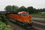 BNSF 5900 In DPU mode helps push a load of empty coal hoppers back north