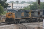 CSX 61 (Dash8-40CW) Leads off coming across the NS line after awaiting for NS 9409 to clear the diamond