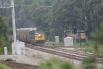 CSX 667 (AC6000CW) comes south with a load of autoracks as a pair of light engines prepair to move some cars off a siding