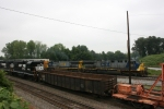 CSX 667 (AC6000CW) comes south with a load of autoracks as NS 7010 (GP-50) rumbles north