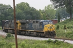 CSX 545 (AC4400CW) mixed freight pulls to a stop prior to the diamond
