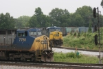 CSX 7781 (Dash8-40CW) & CSX 545 (AC4400CW) sit awaitng to proceed as a NS local comes across the diamond here at the Howell wye