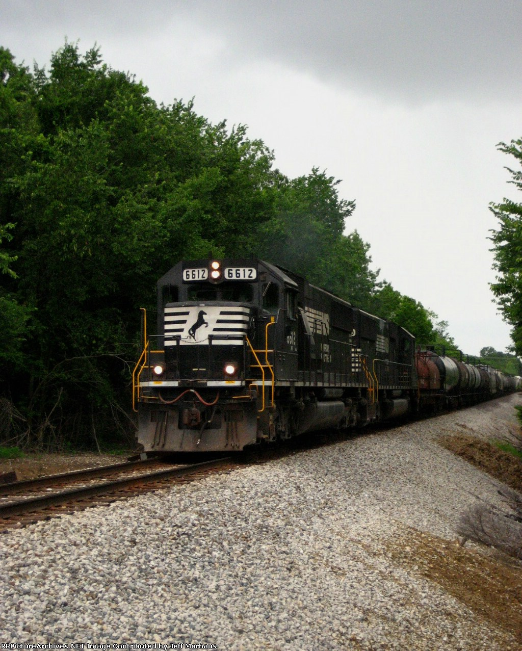 NS 6612  Heads east slowly with a long mixed freight.