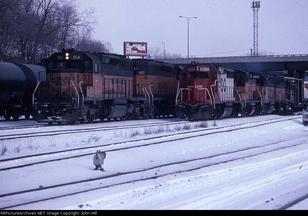 1390-06 Westbound SOO/MILW freights pass Hoffman Ave