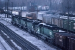 1389-14 Eastbound BN ore train passes MILW Pigs Eye Yard