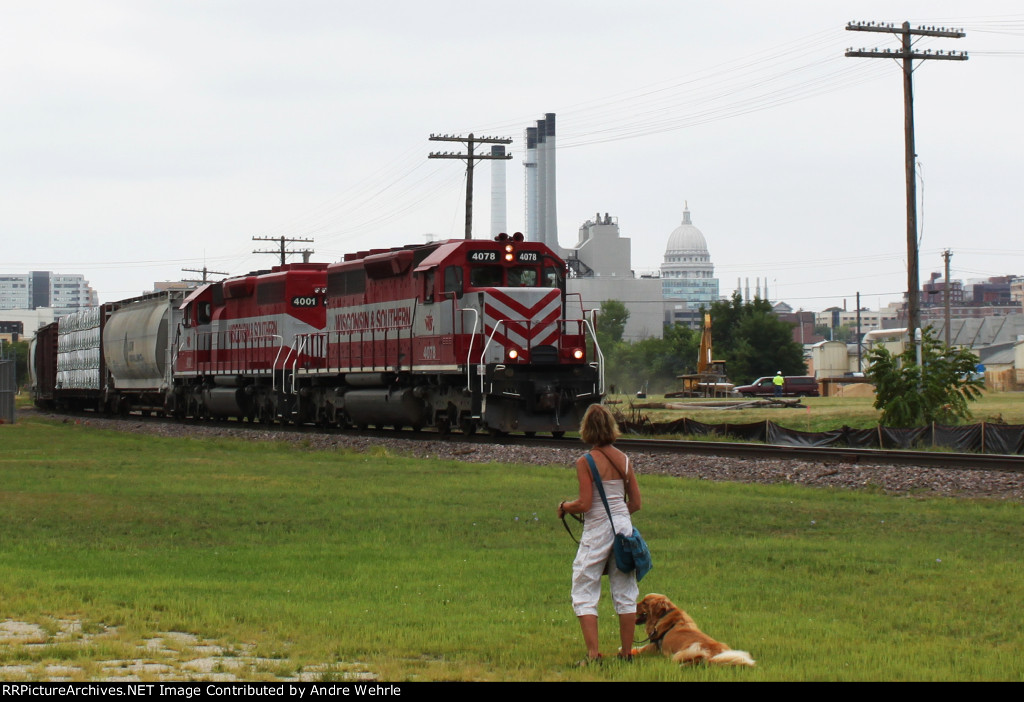 WSOR 4078 passes the dog park with the MG&E stacks and Capitol dome in the distance