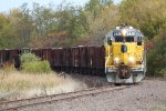 WAMX 3928 rounds the Cheryl Parkway curve with an L461 ballast dump job