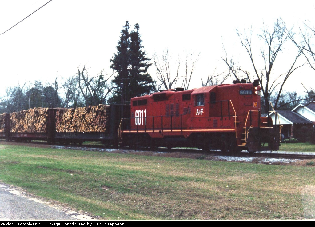 AFLR ex C&O Geep hauls loaded pulpwood destined for Brewton, AL on CSX at Samson, AL.  The train rarely went south of  the Samson woodyard except on rare occasion to deliver grain cars to a Co-Op in Marianna at the end of the line.