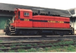 Sitting by the depot turned headquarters for the Alabama & Florida RR, this NW2 is sporting AFLR colors.