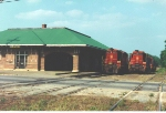 After a stint in local hands, the AFLR was purchased by Pioneer Railway group under the same name.  The remaining operable original three red Geeps were joined by three GP16 units still in FLS and CSX colors.  All six units pose beside the Andalusia depot