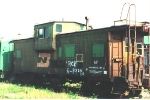 Former BN caboose sits behind various passenger and vintage equipment at the Three Notch RR Museum in 1991.  The car was on the end of two parallel spurs between the old CofGA depot (now the museum) and the L&N depot