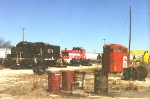"Shot of the makeshift open air ""repair shop"" in the 1990s just north fo the AGLF headquarters on Coastline Road.  By this time Claussen owned the Laurenburg Southern RR and all its operations."