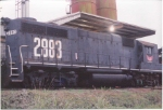 Wiregrass Central GP38 sits at the feed mill at Enterprise on the inbound train in the 1990s