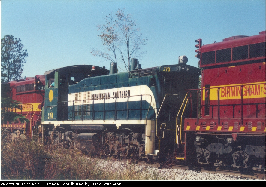 BS 370 is bracketed by two DMIR first generation SD units as it muscles ore jennies out of Birmingport in the late 1990s