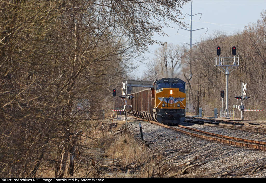 After waiting on two mainline eastbounds to clear the junction, 813 finally heads for the power plant