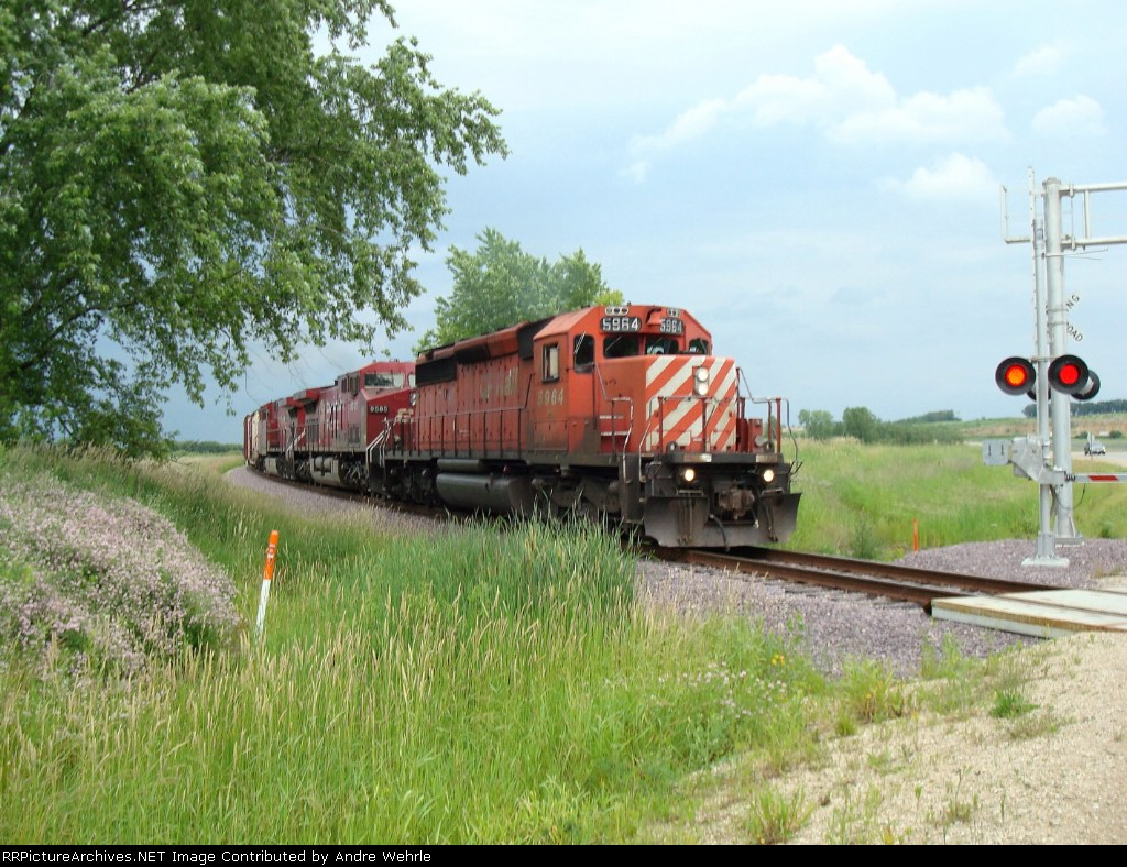 CP 5964 on the move again, about to cross County CV