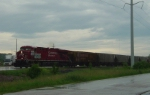 CP 8795 leads a detoured unit grain train across Highway 51 on the Madison branch