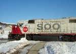 SOO 4419 passing through a residential area