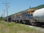 NECR locos 3851 (lead) with 3844 3847 enter a yard siding with 88 car freight train