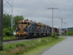 NECR 3848 leading an all NECR locomotive consist & freight train slowly into the yard