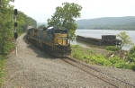 CSX autorack train passes the barge hulk