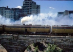 "Eastbound Amtrak ""Hiawatha"" departs GN depot on Stone Arch Bridge"