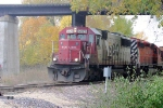 With SOO and CP Pac-Man power, the Shakopee job passes under the MN&S bridge on the UP ex-CMO