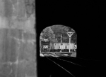 NS Local coal train switching empties at Farm seen through the tunnel