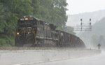 NS 8753 pulling the local through a storm