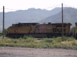 UP 6034 leads a WB coal train at 4:37 while stopped and being refueled