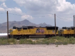 UP 5119 leads a WB doublestack at 12:26pm (tied down)