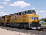 UP 5509 leads a string of cars to be cut and left in Alfalfa at 12:16pm