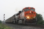 Just east of down town, an eastbound coal train from the Powder River Basin rolls through with BNSF  GE and EMD power
