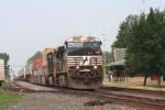 A hotshot UPS/stack intermodal roars eats on # 2 track into the mid morning haze
