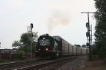 A lone SD40-2, running  backwards, approaches the C&O diamonds