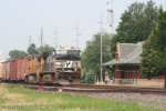 An Eastbound manifest rolls through town past the restored station