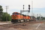 """BNSF GE's come off the B&O and head west on the C&O with """"F"""" Tower in the rear"""