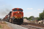 Train U994 with an all BNSF lash up, rolls east in the midday sun...