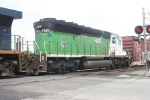 "HLCX 7149, ex BN ""natural gas"" unit, passes through town westbound"