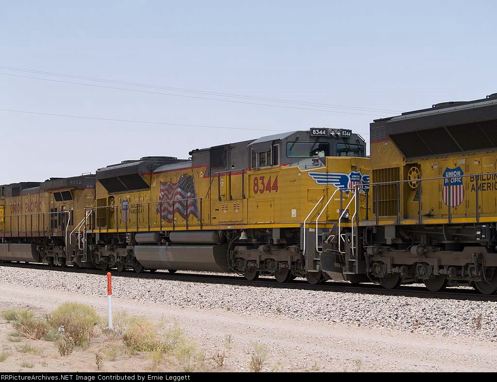 UP 8344 #2 power in an EB doublestack at 12:15pm